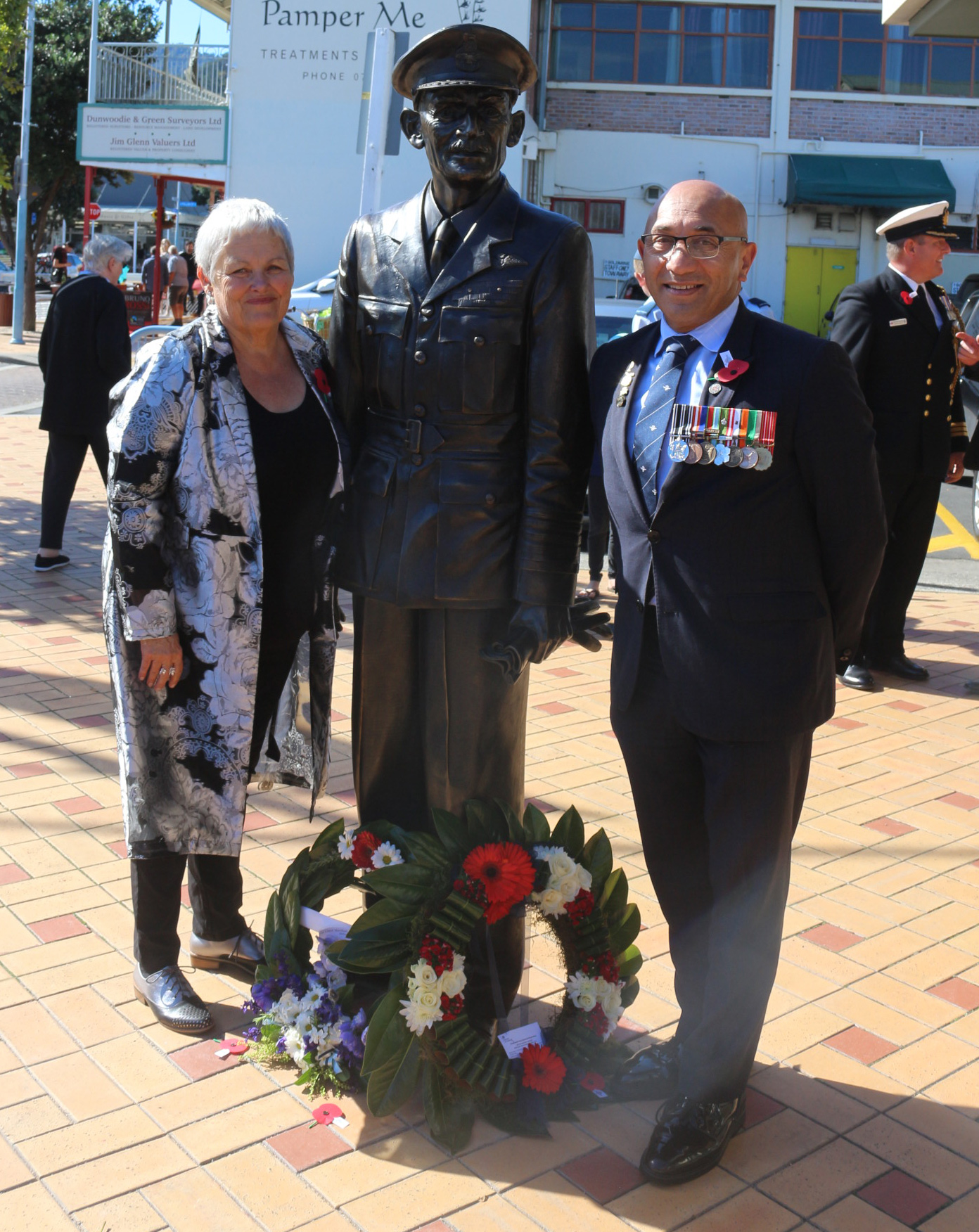 Thames Ward Councillor Sally Christie and Defence Minister Ron Mark flank the statue of Sir Keith Park