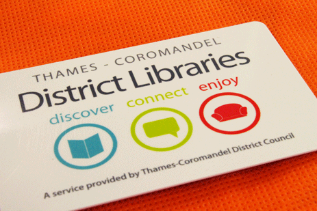 Graphic of a library card on an orange bag